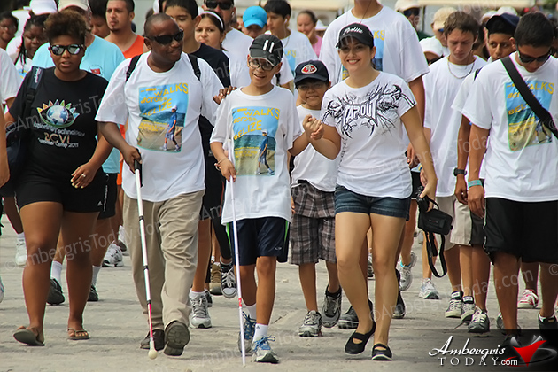 Angel Perlita Zapata Joins Rowan Garel's Walk Across San Pedro, Ambergris Caye, Belize