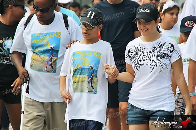 Angel Perlita Zapata Joins Rowan Garel's Walk Across San Pedro, Ambergris Caye, Belize