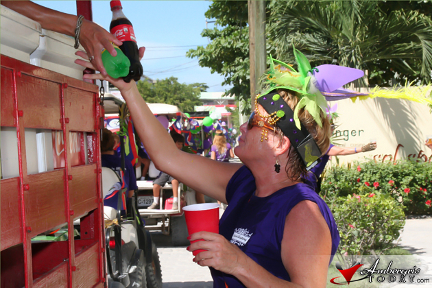 Lady Dixie Bowen spreads the cheer with Belikin Beer and Coke Products