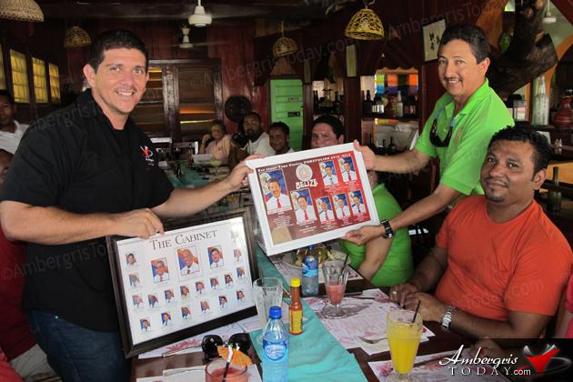 San Pedro Town Council Media Meeting -Mayor Danny Guerrero presents gift to Dorian Nunez of Ambergris Today