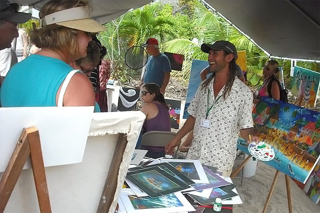Art display by Walter Castillo and Melody Sanchez Wolfe at Placencia Sidewalk Art Festival