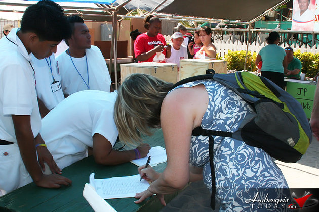 Tourist signing the petition against offshore exploration and drilling in Belize