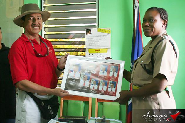 Mayor Daniel Guerrero presenting a framed poster to OC Assistant Superintendant Viene Robinson