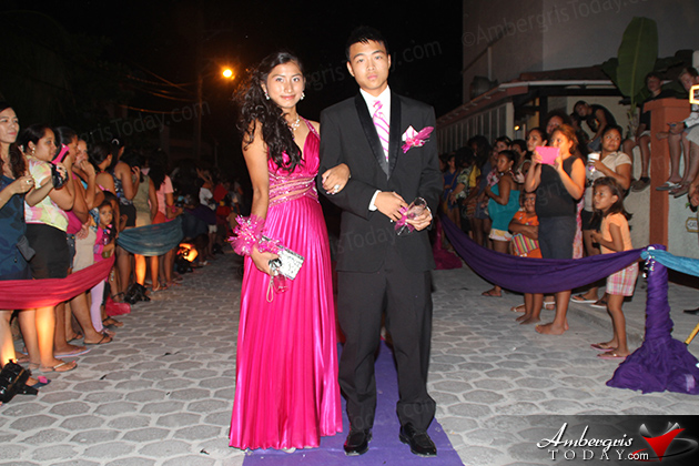 "A Night In Dubai Themed Prom for San Pedro High  San Pedro High School Prom Night has become a spectator's sport on Ambergris Caye as hundreds flocked to the street outside of Banana Beach Resort, prom venue, to marvel at the beautiful dresses and suits worn by the senior class of 2013.  This year's prom theme was ""A Night in Dubai"" and was held at El Divino Restaurant on Thursday, June 13, 2013.  Prom King was awarded to Min Ling Chen Prom Queen was awarded to Arian Paz"