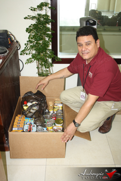 Tropic Air Assists Six Families with Christmas Food Drive