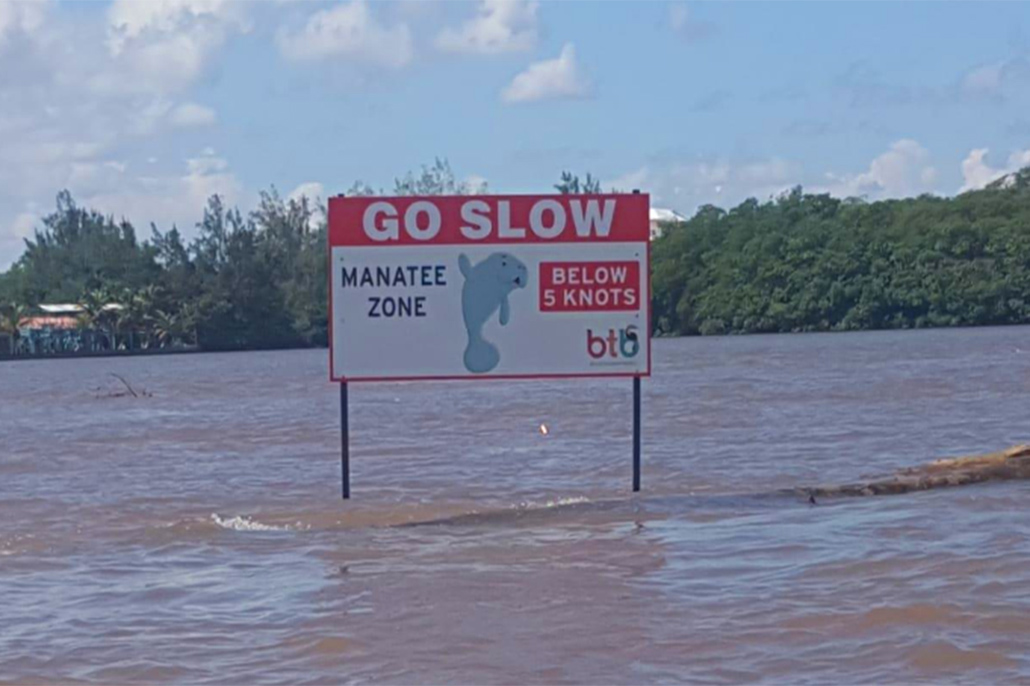 "Protect Our Manatees - ""Go Slow"" Sign Installed on Belize River"