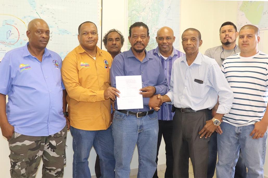 Belize Minister of Transport Signs New Statutory Instrument Regarding International Buses