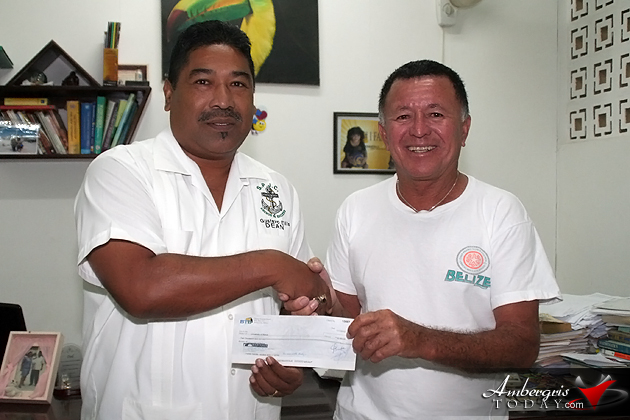 Gustavo Ellis, Dean of SPJC accepts check from Hon. Manuel Heredia
