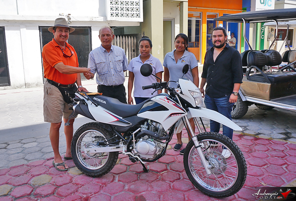 Toucan Gift Shops Donate Motorcycle to San Pedro Police
