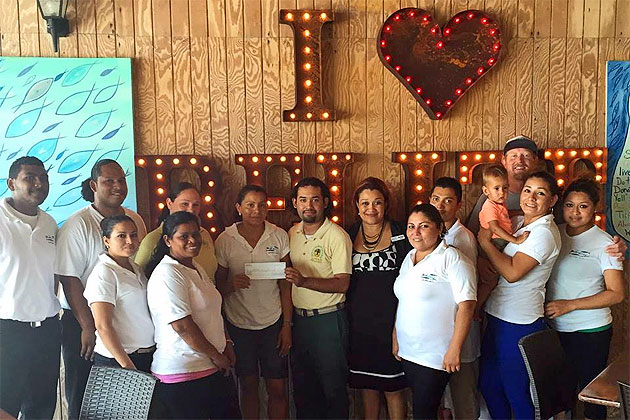 Blue Water Grill presents cash donation towards ACES Scholarship Program