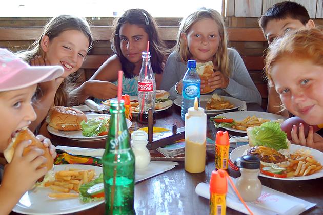 Island Academy Students enjoying burgers at Tackle Box