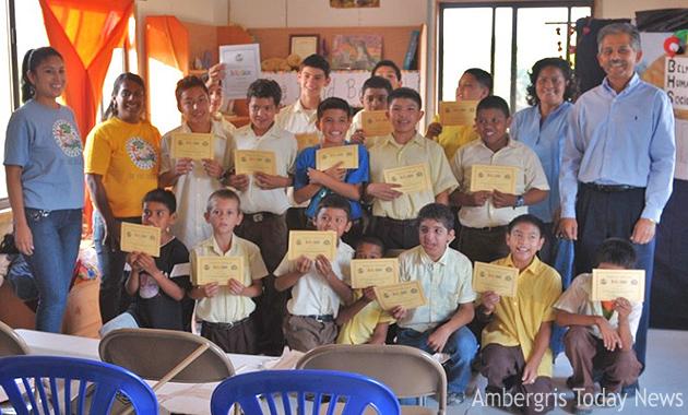 Graduating class with Be Kind BElize Educators and US Ambassador