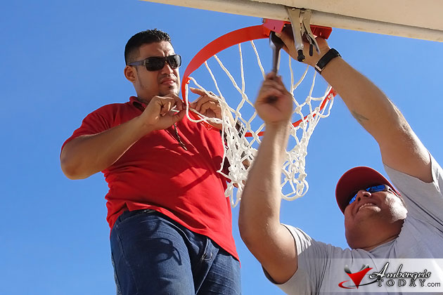 Town Forman Freddie Gonalez Jr and Councilor Gaby Nuñez install rims