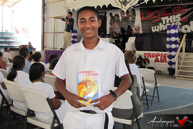 San Pedro High School Student obtains a book from Consuelo Kickbusch