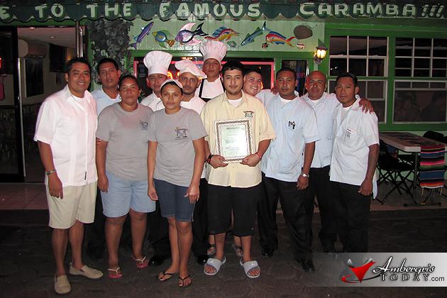 Staff of Caramba Restaurant with TripAdvisor Award