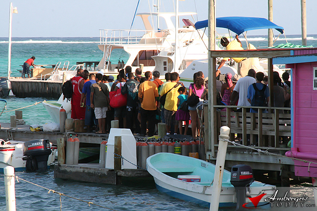 Island visitors flood the water taxi terminal as Costa Maya Weekend ends