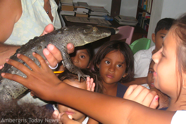 RC School Students interact with baby crocodile at SP Library