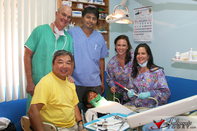 Dr. Lam is accompanied by Dr. Jim Snider, Assistant Ashley Czech and Hygienist K