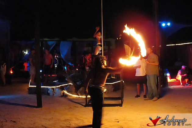 Fire dancer and GoGo dancers at Eclipse's Full Moon Party Kama Lounge