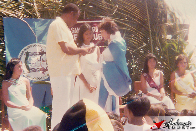 Elsa Paz passing on the Miss San Pedro crown to Yolanda Gutierrez