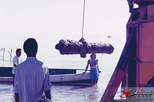 A Spanish Cannon being taken out of the sea.