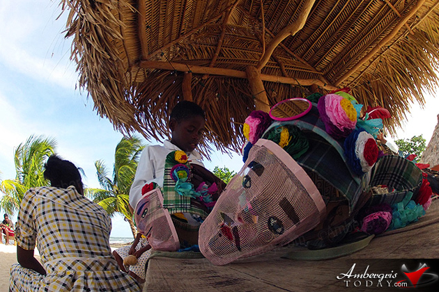 Young Garifuna Jankunu dancer prepares his costume before his dance