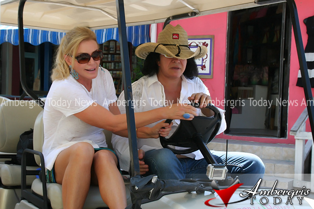 Shannon and Gene ride on golf cart in San Pedro, Belize