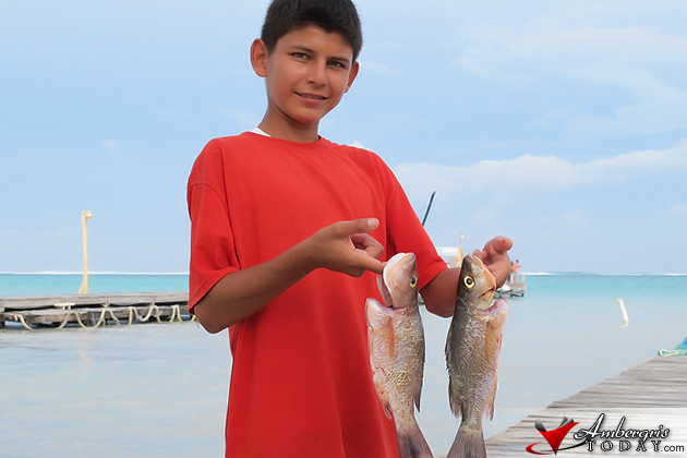 Young school boy showing off his catch