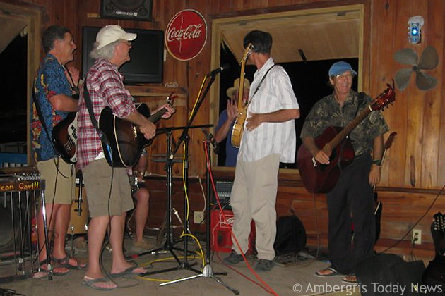Dale Wallace (far right) performs with Jerry Jeff Walker at Wet Willy's Cantina