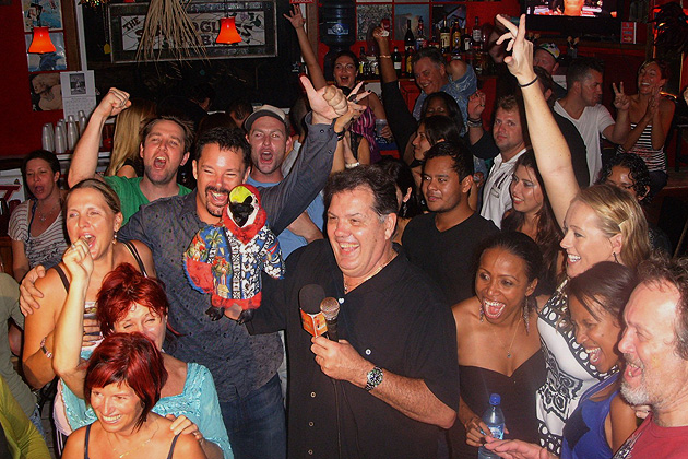 Joey Stevens and Bob the Parrot party at Legends Burger House
