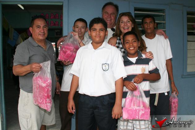 Debbie and Larry Heimgartner along with Mr Manuel Del Valle deliver popsicles
