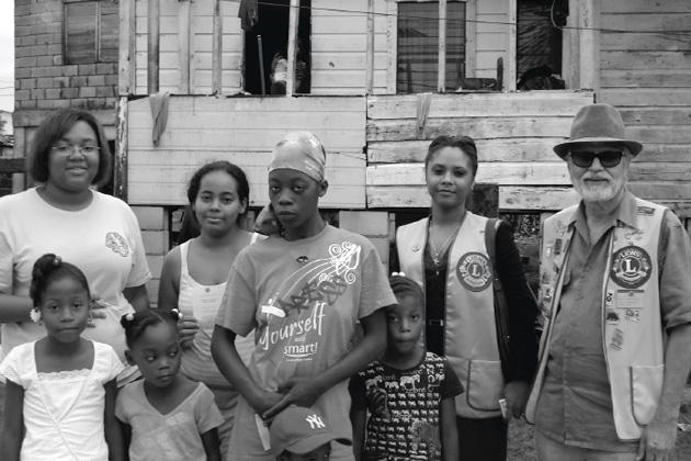 Lions deliver Food Vouchers to Hurricane Richard victims