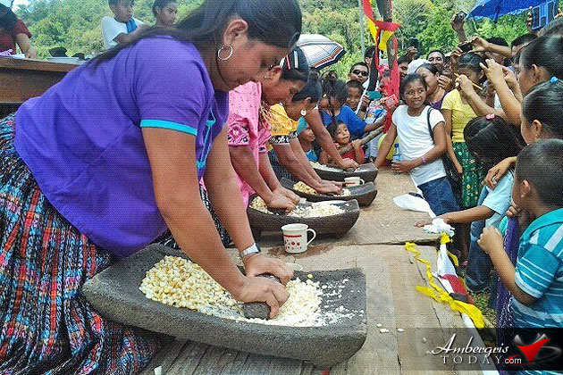 Maya women grinding corn during Maya Day 2015 competition