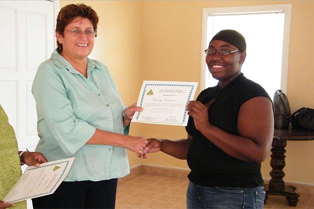 Mayor Elsa Paz hands out certificates of appreciation