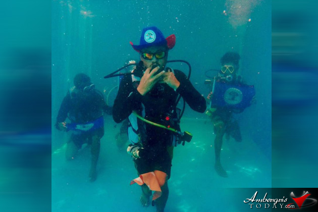 Local Belizean Diver shows his patriotism in underwater pic