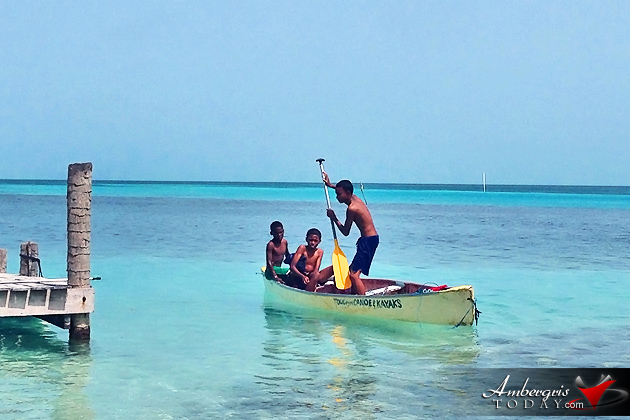 Children having fun in Caye Caulker on a dory