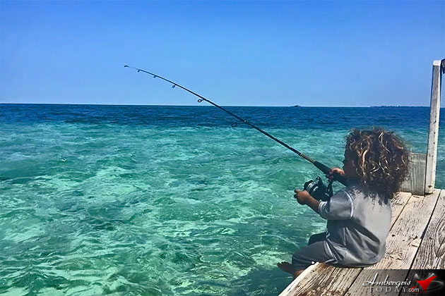 Picture Perfect Postcard picture - young boy fishing in Placencia, Belize