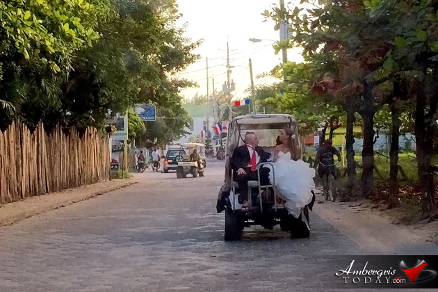 Newly Wedded Couple gets around in San Pedro, Ambergris Caye on golf cart