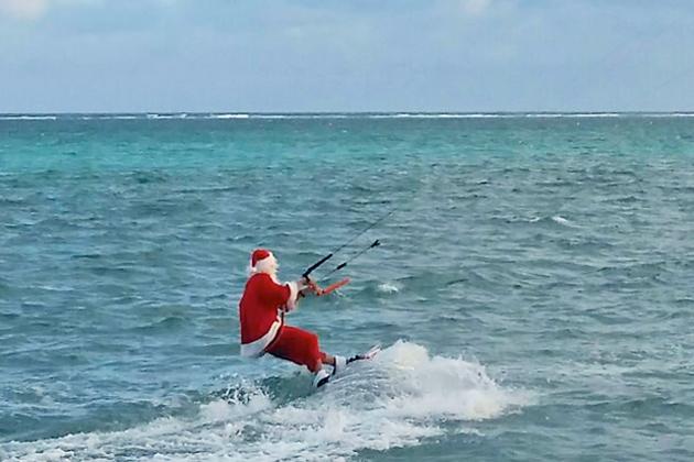 Santa Claus Kite surfing in San Pedro, Ambergris Caye, Belize