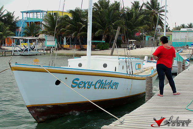 Delsie next to the sexy chicken in Caye Caulker