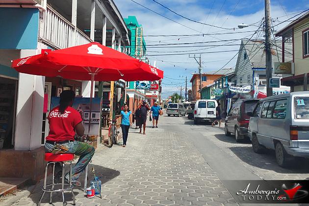 Artist Terryl Godoy paints the skyline of San Pedro Town, Belize