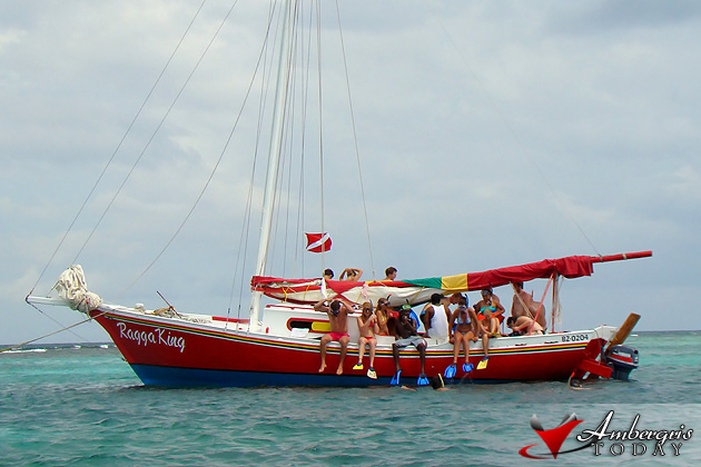 Sailing boat from Caye Caulker takes tourist out to coral reef
