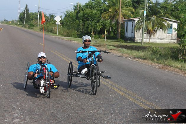 Paraplegic cyclist Jerome Flores rides his trike through Belize