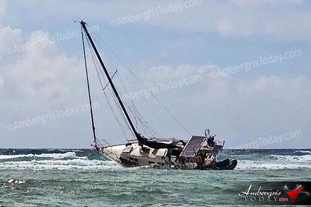 Private Sailboat Stuck on Reef by Hol Chan Marine Reserve