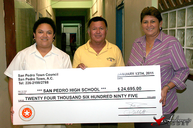 VP of San Pedro High accepts check from Hon. Heredia and Mayor Paz