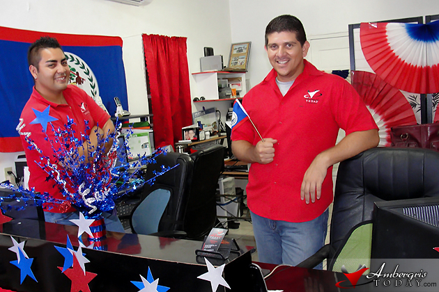 Ambergris Today office explodes with Belizean Flag colors