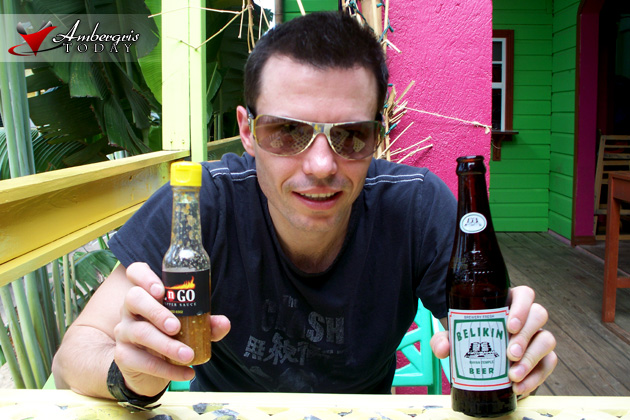 Shawn Brady with his Grill N' Go Hot Sauce and Belikin Beer