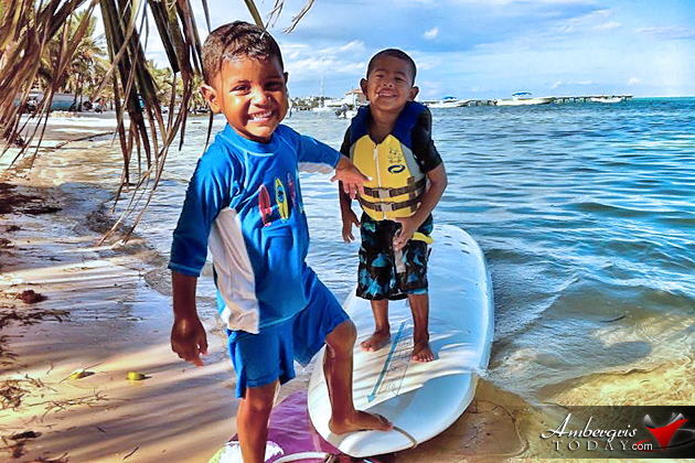 Two boys beat the heat in San Pedro playing with surfboard