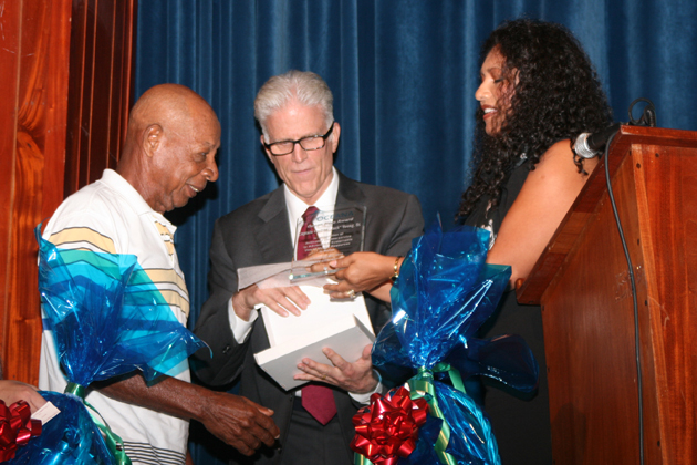Mr. Jack receives award from Ted Danson and Audrey Matura