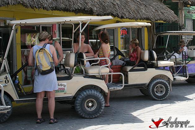Tourist on golf cart in San Pedro, Ambergris Caye